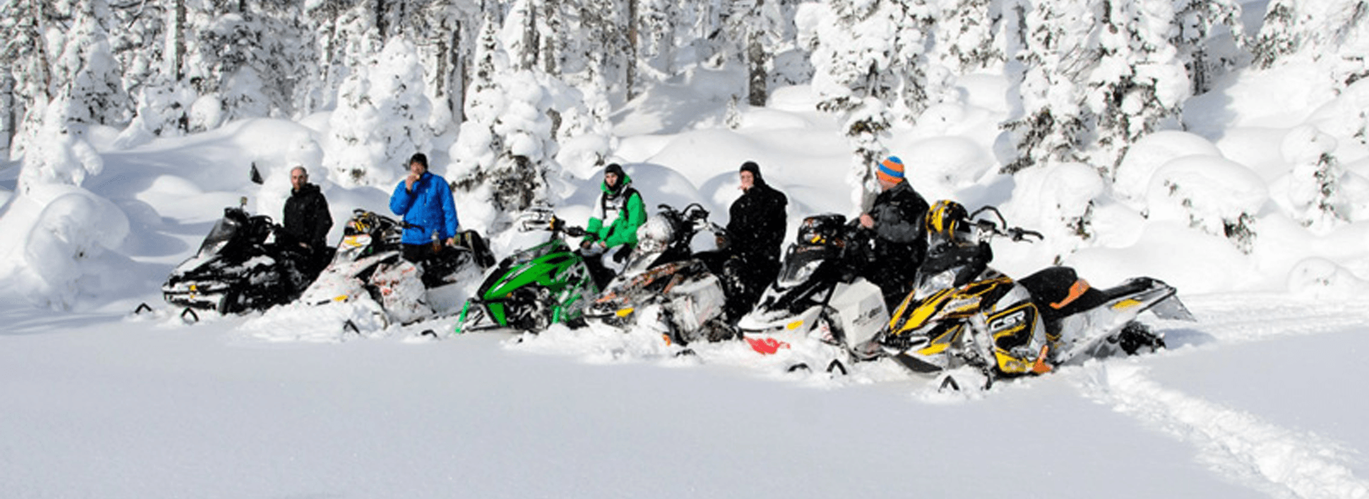 snowmobile tours group resting