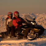 mountain snowmobiling at sunset